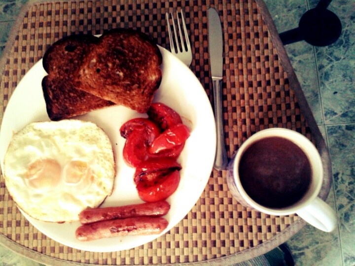 Colombian eggs, sausage,  tomatoes, toast and chocolate style!!