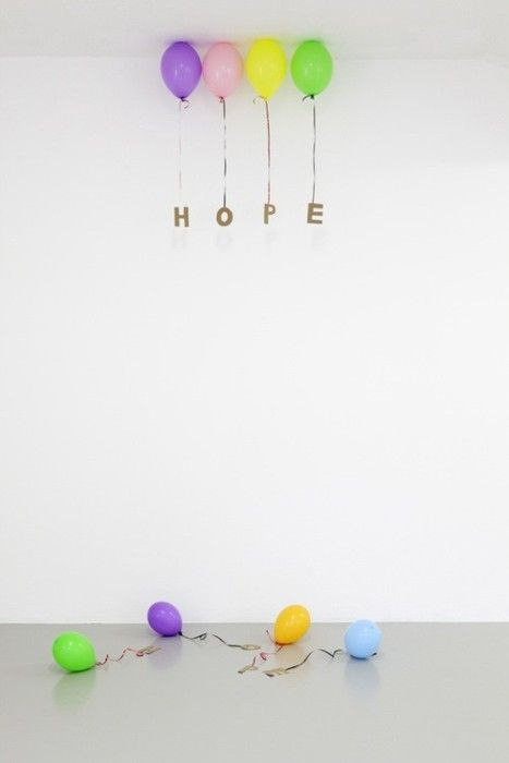 Tie gold letters to balloons, cute decorating idea for a party