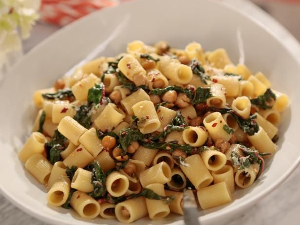 Rigatoni with Greens (Chickpeas and Capers) Recipe from Giada DeLaurentiis | Food Network. Note: Made with swiss chard but can sub spinach.