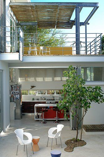 i love the reed covered 2nd floor terrace contrasted with