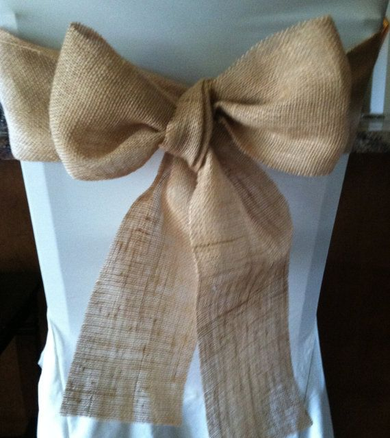 Great for a rustic or vintage wedding, these burlap sashes are cut specially to the size most weddings use! This sash measures 4 x 96 long.  This Sash does have SERGED edges! The sashes do NOT come tied as there is just too much variation in the size/width of chairs. Please NOTE your wedding date in the Notes section of the order! Also, see our burlap table runners with a variety of lace styles! Thank you again! Happy Shopping!  Please Find us on Facebook by searching Ruby Design Customs…