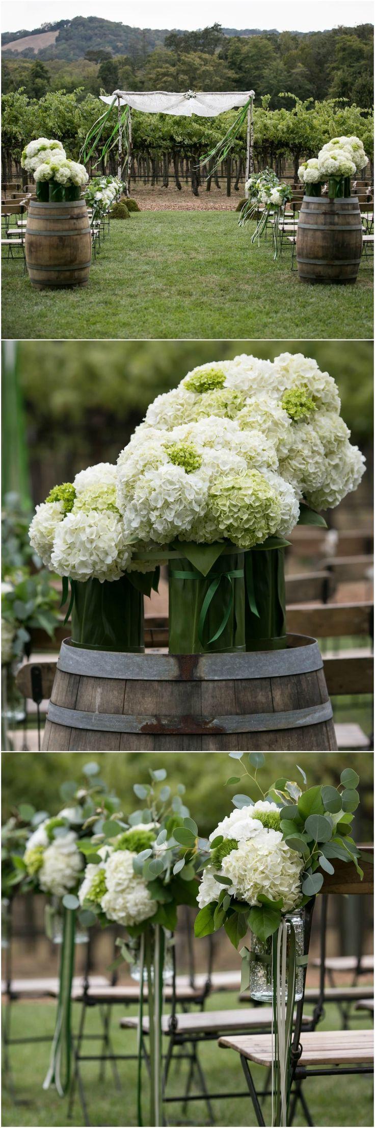 Winery wedding, rustic vineyard, outdoor ceremony, white hydrangeas, wine barrels, green & ivory ribbons // Arrowood Photography