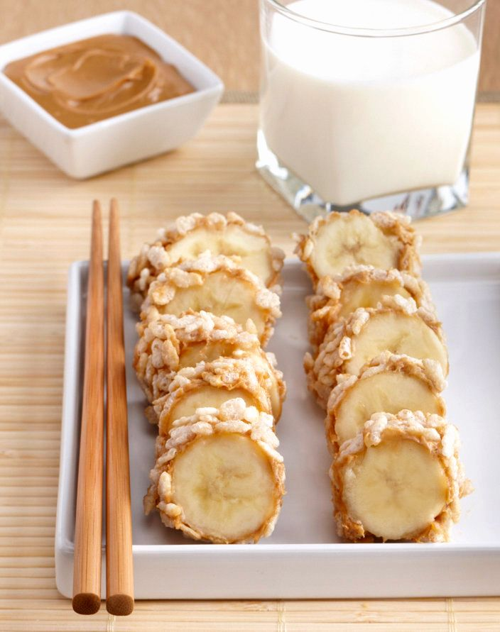 """Breakfast: Crispy Rice Peanut Butter Banana """"Sushi"""".    Spread peanut butter over the outside of the banana, and then roll in cereal until coated. Cut into thick slices and serve with a glass of milk."""