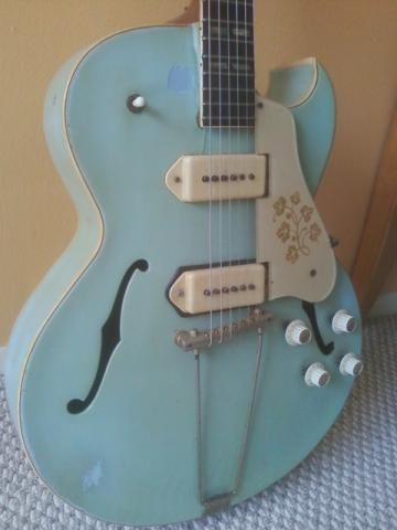 Vintage 1953 Gibson Hollowbody. Blue. Dog ear P-90 pickups in white look great on this.. Look like soap bars?