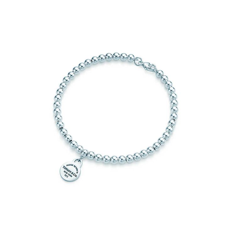 Return to Tiffany™ mini round tag in sterling silver on a bead bracelet.