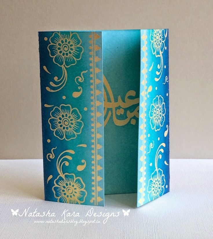"per website ""I dream in color.   she started by cutting and scoring 120LB card stock so it would open in the front. masked off the back and stamped and heat embossed the two front panels with images from the ""Henna Elements"" stamps set from Altenew. I used wow embossing powder in pearl gold. distress inks and got inky with tumbled glass, peacock feathers, salty ocean and chipped sapphire. Next I heat embossed the Eid greeting, from the ""Eid greetings"" set, on the inside and inked that up…"
