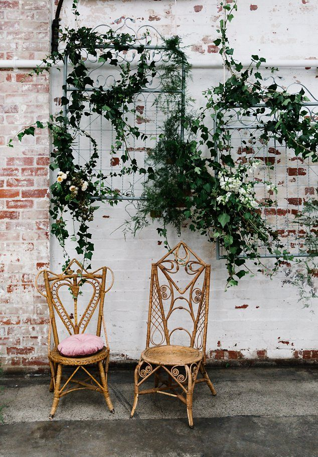 Floral installation, greenery at wedding reception. Hanging installation with peacock chairs