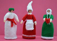 This is St. Lucia, a Christmas Elf and a Carol Singer Peg Dolls. They are knitted peg dolls using 12cms wooden pegs. This pattern is worked flat & would suit a beginner. http://www.ravelry.com/patterns/library/christmas-peg-dolls
