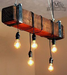 - Order Details - Description - Specs - **Free Shipping Nationwide** This is a one of a kind beam chandelier made from reclaimed wood made to look like a beam - Hollow to reduce weight and house elect