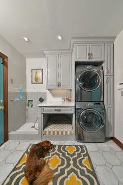 Laundry room make-over makes room for the family dog :: By using a stack laundry pair, they made room for the doggy bed, and a doggy shower...