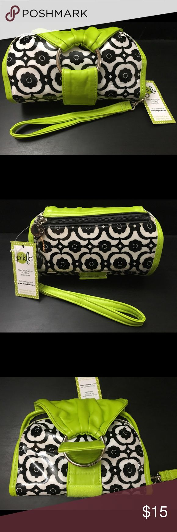 "Sweet Pikle in Licorice Blossom The ""In A Pikle"" bag is the perfect companion for the busy person on-the-go. It's unique patented design is fashionable and functional! The bag is approximately 10″ x 7″ open and 3.5″ when closed. This bag has a handy ring closure. It can easily be opened single handedly. The sturdy strap inserts into the large ring and folds over itself. It is secured in place with a hook and loop fastener. It does not come with the interior pouches. Bags Clutches & Wristlets"