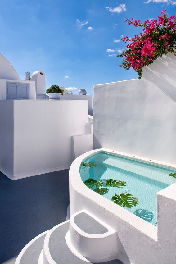 Greece Travel Inspiration - Simplicity in White. Santorini, Greece | Architecture Pools | Rosamaria G Frangini
