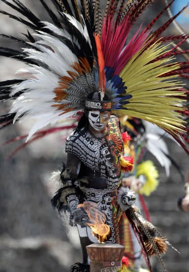 A mexican in Aztek costume during the flame ceremony in the panamerican games at the dig of Teotihuacan, Mexico. photo: Henry Romero/reuters/scanpix