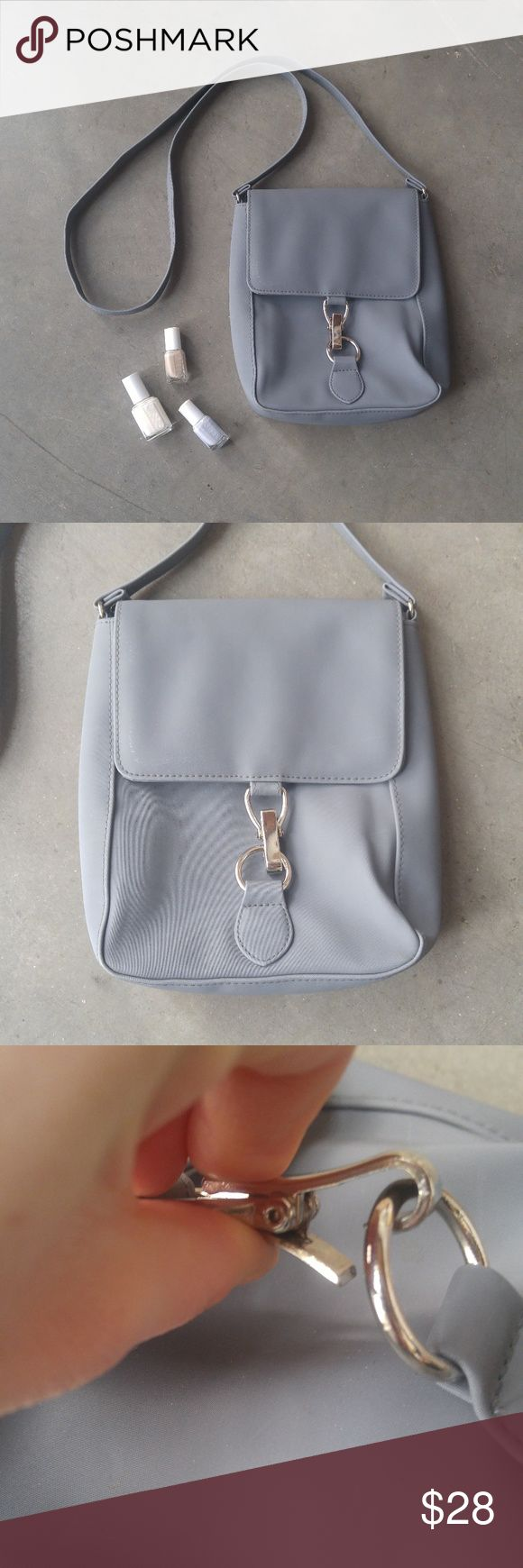 Gray Square Shoulder Bag Gray square shoulder bag in excellent condition! Minor scratches on front (4th photo) and minor water spots (I think) on back (7th photo). Classy neutral gray with silver clasp in front. Vinyl material. One inner pocket. No brand tag. No trades. No modeling. Make a reasonable offer. Thanks! *Cover photo accessories not included* Bags Shoulder Bags