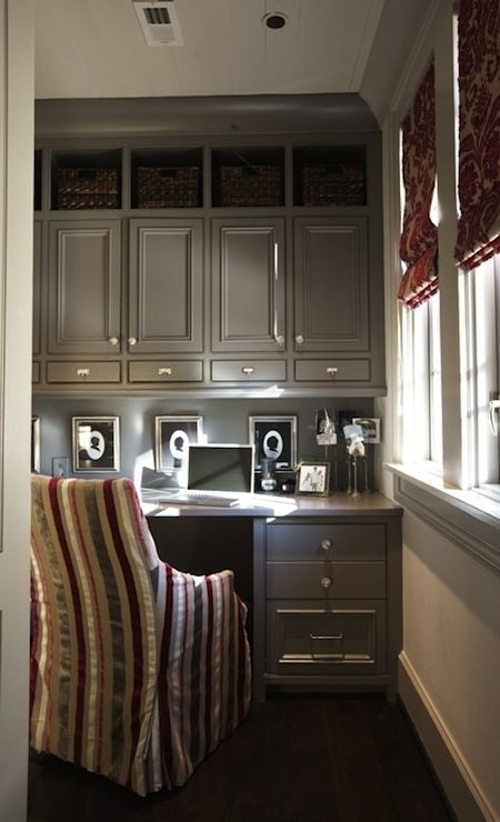 Tracery Interiors: Nook office with floor to ceiling built-in glossy gray cabinets & desk with marble top, ...