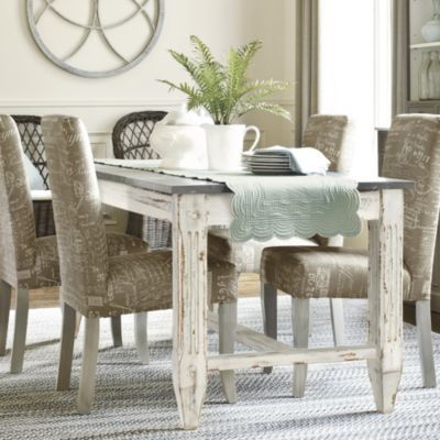 Table with distressed legs and zinc top-but cross bar at end makes it hard to put chairs on end.. Messina Dining Table  - 76' | Ballard Designs