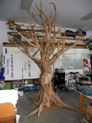 Tree could be made out of card board like this tree, as its cheap and affordable!