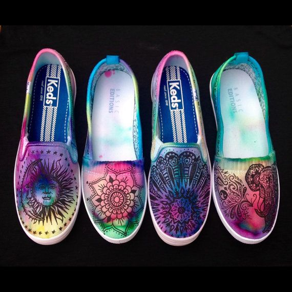 These shoes start out as white and are tie-dyed and decorated with a hand-drawn tapestry inspired design that is completed with a black fabric