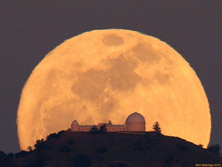 As viewed from a well chosen location at sunset, the gorgeous Full Moon rose behind Mount Hamilton, east of San Jose, California on March 7