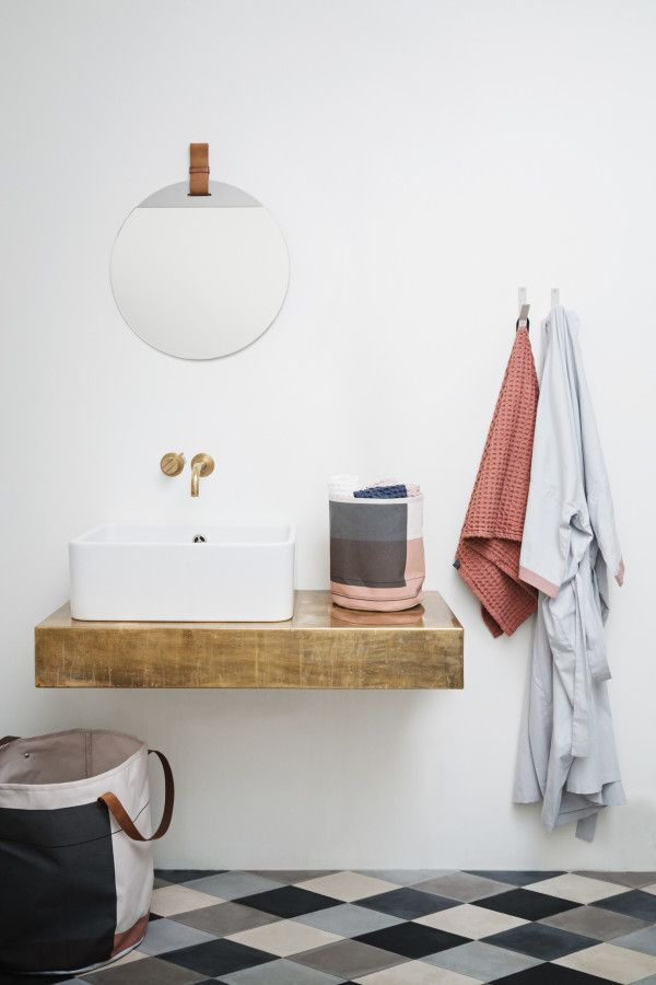 A really nice, simple Scandi style bathroom from ferm LIVING'S Autumn/Winter 2016 Collection. Really like the bathroom accessories here, the round mirror and the diamond tiled grey floors.