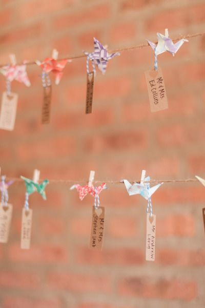 DIY paper crane escort cards: http://www.stylemepretty.com/2015/02/18/urban-chic-chicago-loft-wedding/ | Photography: T&C - http://www.tandcphotographie.com/