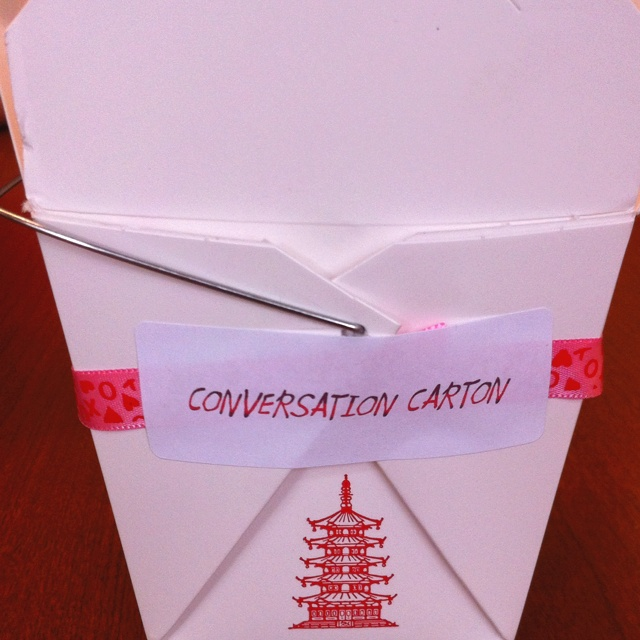 Valentine's Day craft...Conversation cartons. Chinese food cartons decorated with ribbon and the little label. Cut fortune cookie sized strips with preprinted conversation starters to be used with the kids at the dinner table. Prompts can be themed for Valentine's Day or ask general questions about the school day.
