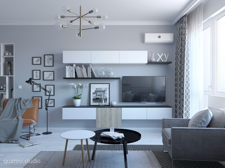 Living room in Scandinavian style. Minimalistic TV unit, bending tables, armchair bye Jesse.