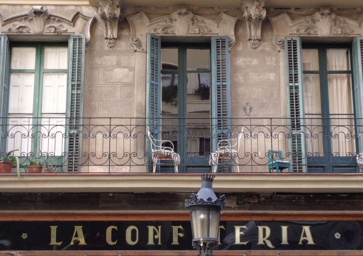 large balcony with green painted windows at carrer Sant Pau, up to café La Confiteria #Barcelona #balcony #confiteria