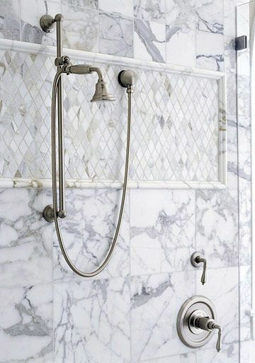 Master Bath - Lustrous polished Carrara marble tiles cover the shower walls. A panel of diamond-set tumbled-marble tiles provide visual contrast.  Visual contrasts excite the senses.  A timeless look. <3 #bhg.com