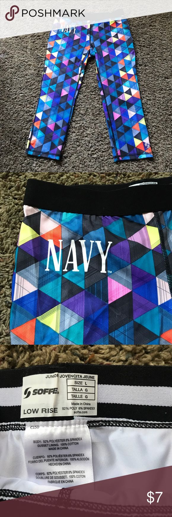 Funky Capris Such a fun pattern. Say size large but I am a large and they were too tight much more like a medium. Say Navy, they were bought from a Navy store on base. Form fitting and dri fit. Pants Capris