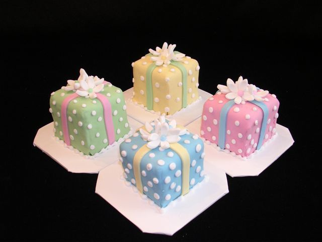 Pastel polka dot mini cakes - I covered these cakes in different colors of fondant and added fondant ribbons and flowers, polka dots are RI. I made these and the cookies to match for the plates that the client was using. They were a lot of fun!