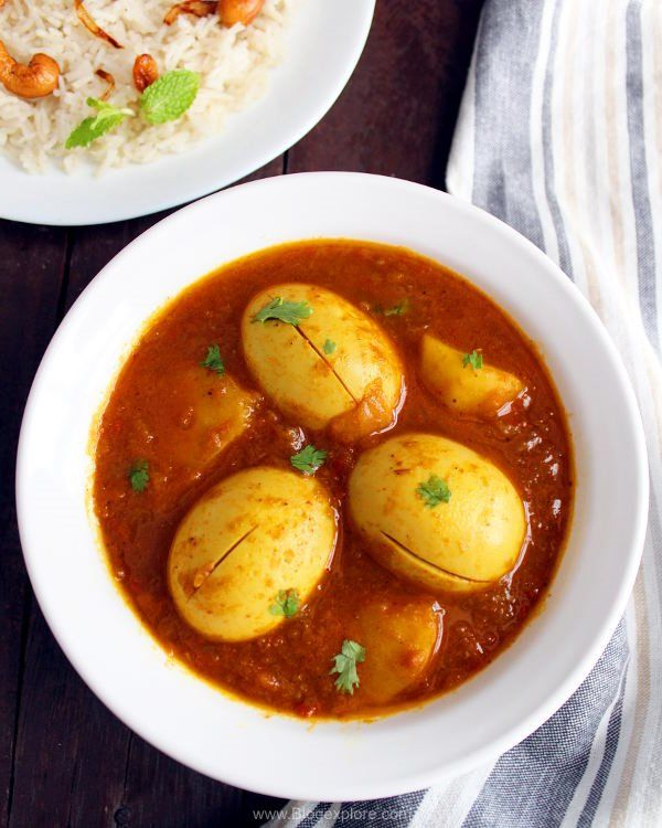 Bengali egg curry / dimer jhol recipe - a simple and comforting potato and egg curry in Bengali style. Goes well with rice or chapathis.