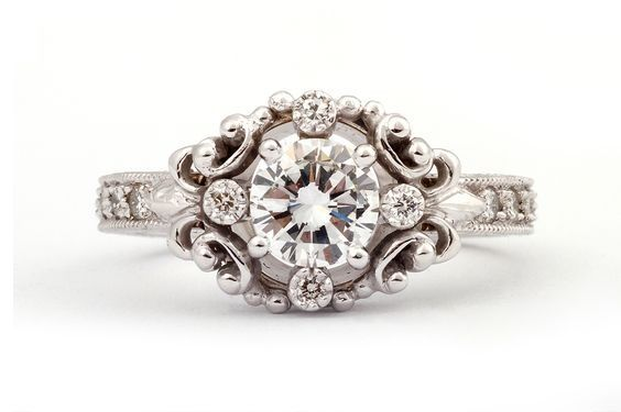 GALACIA DESIGNER JEWELLERY-Natural round brilliant-cut diamonds set in white gold with filigree patterns, diamond pavé shank and completed with hand engraving.