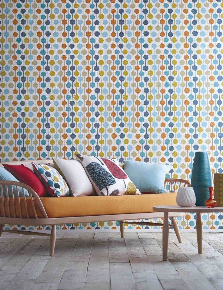 We love the Taimi wallpaper which is cheerful stripe and circles combo. The sulphur, tangerine and kingfisher colourway is so striking!