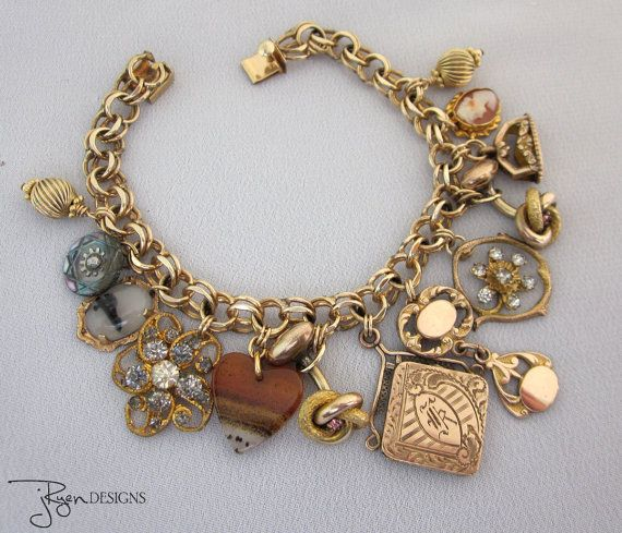 100 Year old Victorian charm bracelet with repurposed / upcycled accents including locket, cuff links and watch fobs. One of a Kind designs from JryenDesigns