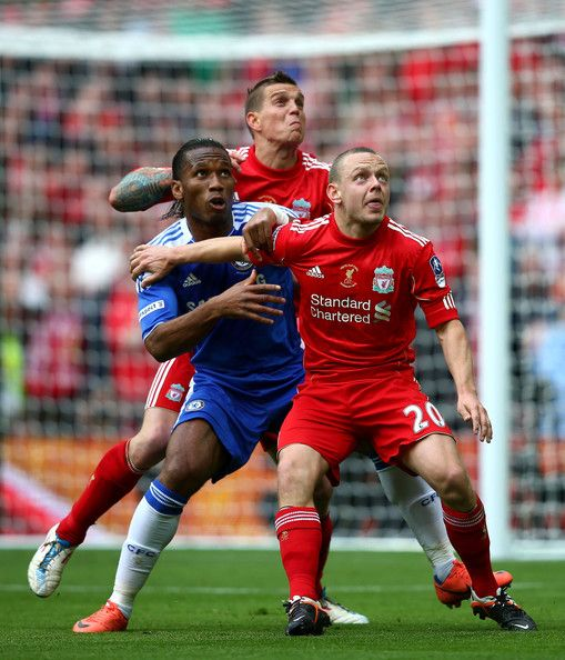 Didier Drogba of Chelsea (R) is marked by Daniel Agger (C) and Jay Spearing (L) during the FA Cup with Budweiser Final match between Liverpool and Chelsea at Wembley Stadium on May 5, 2012 in London, England.