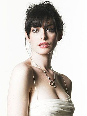 Anne Hathaway with her dark hair and eyes and fair skin has High Value contrast