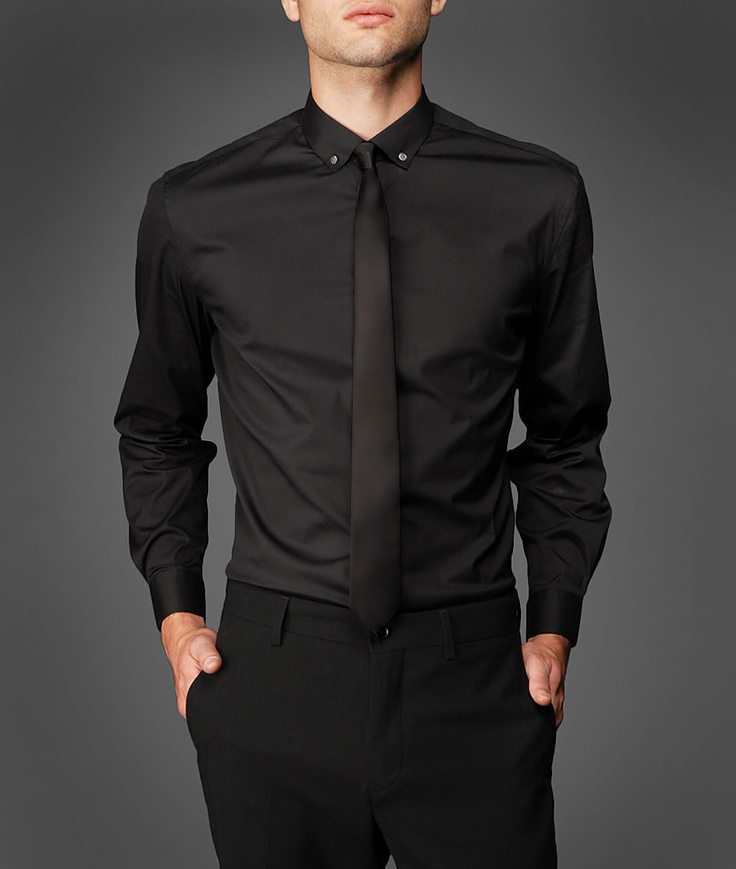 Slim fit dress shirt with contemporary cut and a narrow button-down collar.  The shirt features back darts, adjustable barrel cuffs and genuine Mother of Pearl buttons. Perfectly designed to be worn with a variety of dress wear.