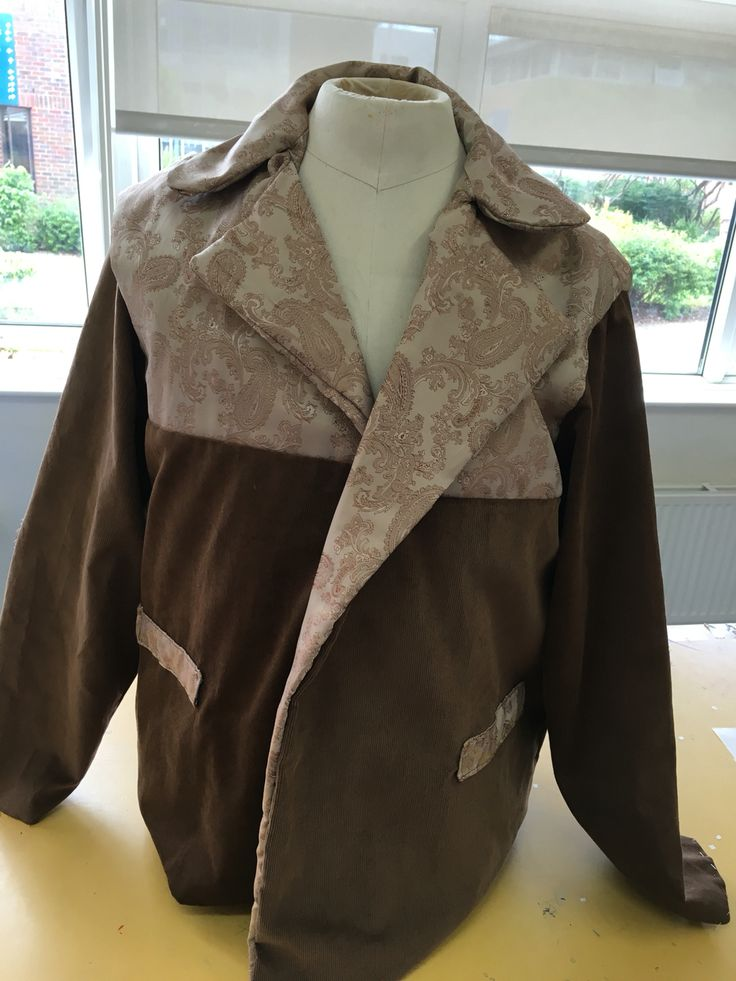 This is how the garment looks having done the tailored collar, lapels, and lining sewn to the armholes.