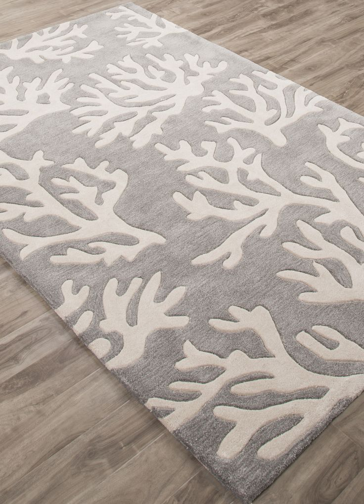 The coral branch pattern is created with carved details on this plush hand-tufted polyester rug.