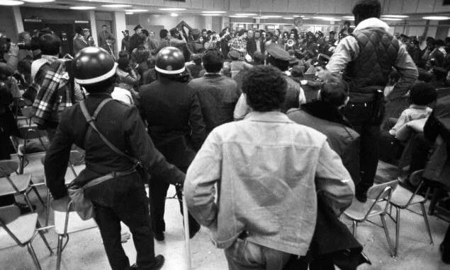 In 1975, inmates at the men's jail on Rikers Island hold five guards hostage and cause $1 million worth of damage, becoming one of the worst inmate riots New York City had ever seen.