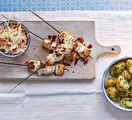 Lemony chicken skewers, herbed new potatoes & apple coleslaw. These kebabs are light and tender. Serve with a contrasting shredded slaw and new potatoes with parsley, mint and chives