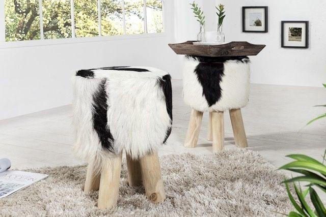 Poef koeienhuid