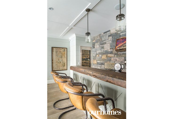 """Leather bar stools align with the family room bar.     See more of this home in """"Get the Royal Treatment on Muskoka's Royal Island"""" from OUR HOMES Muskoka Spring 2017:  http://www.ourhomes.ca/articles/build/article/get-the-royal-treatment-on-muskokas-royal-island  #cottage"""