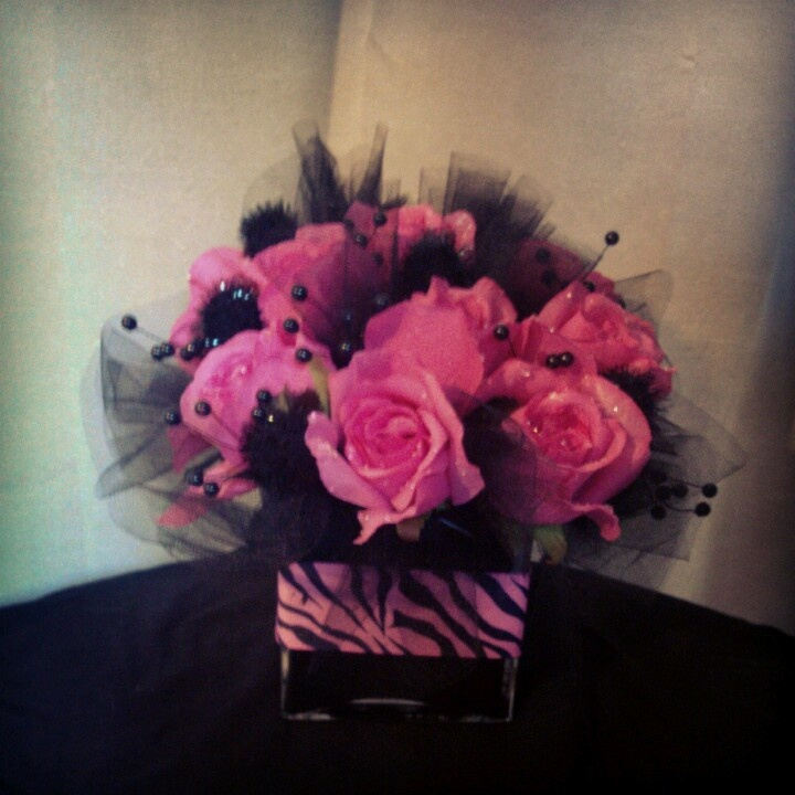 Pink and zebra centerpiece for party :) We love creating!!