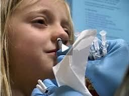 Young girl receiving nasal flu vaccine