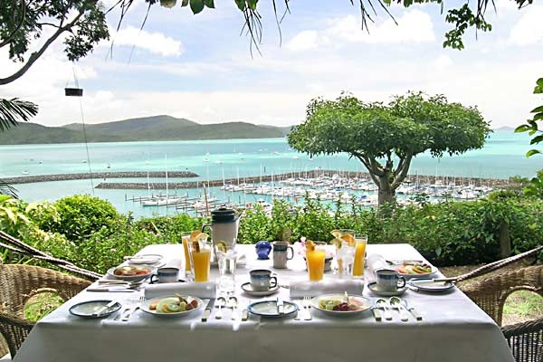 """Whitsunday Moorings Bed and Breakfast, Airlie Beach - """"The repeat visitors list for Whitsunday Moorings Bed and Breakfast is long enough to form its own club. Their shared interests would include a love of matchless Coral Sea panoramas and an addictive desire to gaze at that view while breakfasting on one of the best tropical meals we have seen. Add to that great coffee and morning papers, and it's a club we are happy to join."""""""