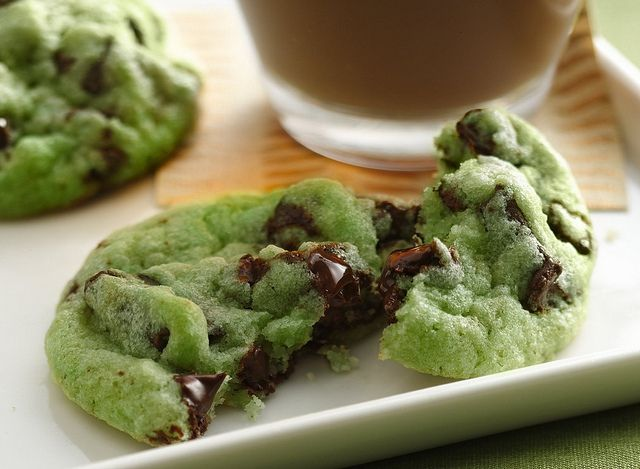 Mint Chocolate Chip Cookies Recipe    1 pouch (1 lb 1.5 oz) Betty Crocker® sugar cookie mix  1/2 cup butter or margarine, softened  1/4 to 1/2 teaspoon mint extract  6 to 8 drops green food color  1 egg  1 cup creme de menthe baking chips  1 cup semisweet chocolate chunks  1. Heat oven to 350°F. In large bowl, stir cookie mix, butter, extract, food color and egg until soft dough forms. Stir in creme de menthe baking chips and chocolate chunks.    2. Using small cookie scoop or...
