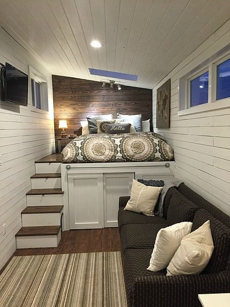 The Fifth Wheels tiny house, from the Tumbleweed Tiny House Company. A 255 sq ft home on wheels with a raised platform for a bedroom as opposed to the usual tiny house loft bedroom.