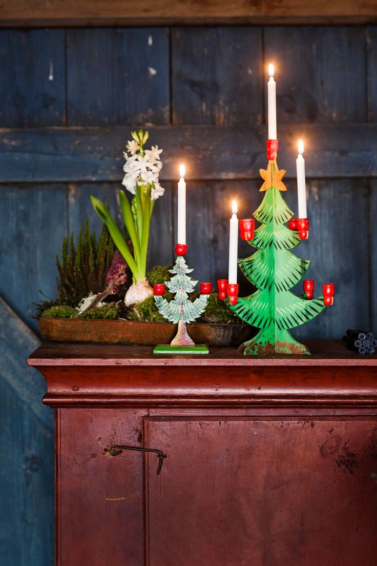 Simple white candles in a tabletop tree display from Sweden - Love the look! www.christmasgiftsfromgermany.com